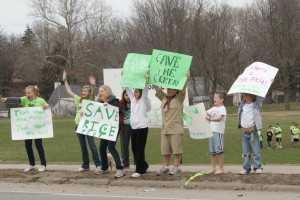 Kids holding signs to save Rice