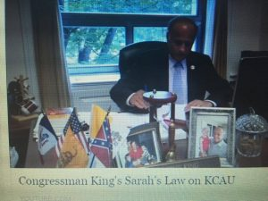King with confederate flag on his desk