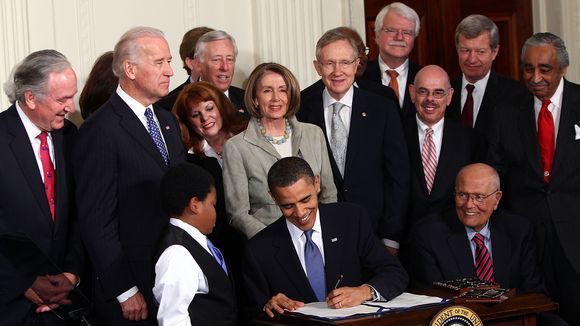 Obama signs the ACA